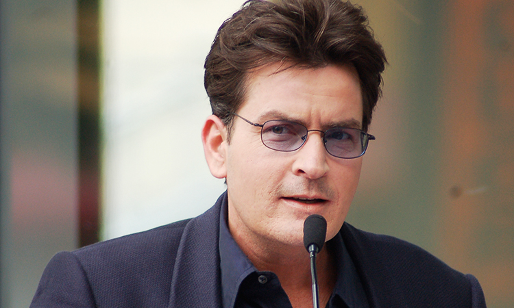 Charlie Sheen with microphone at press conference