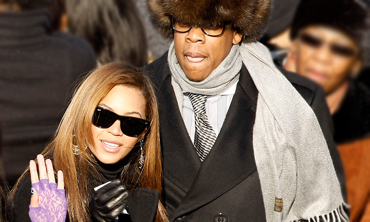 Beyonce and Jay-Z in crowd wearing winter coats
