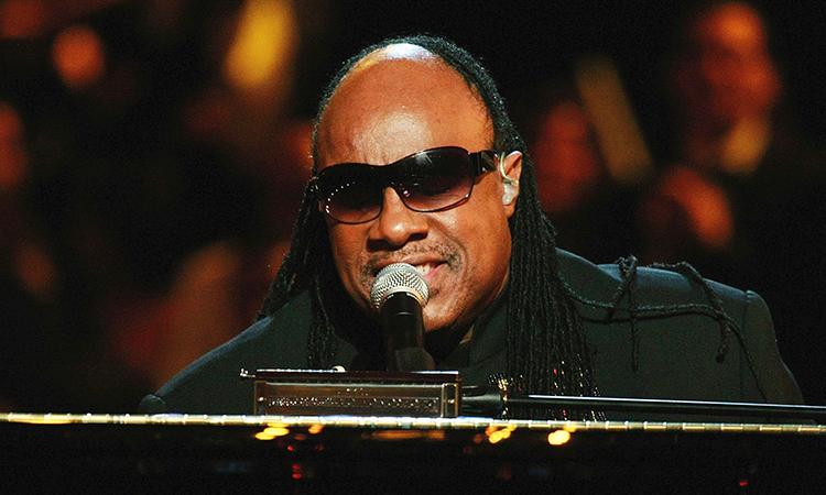Stevie Wonder singing at concert