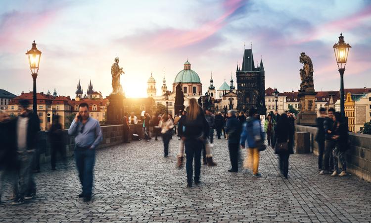 Czech citizens and tourists walking across bridge