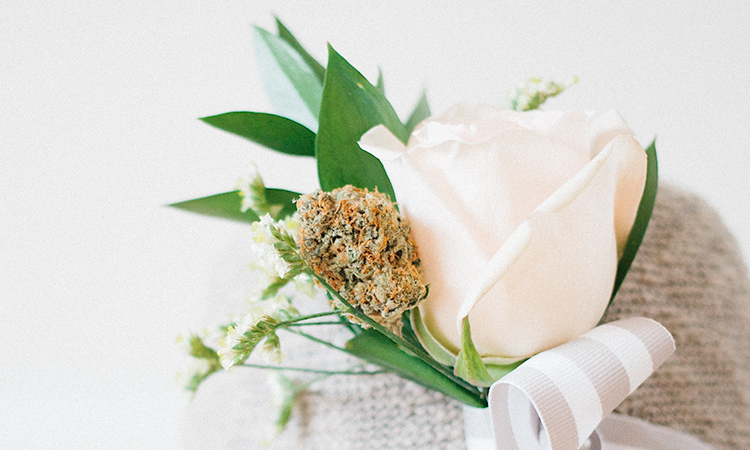 Cannabis boutonnière with white rose on hemp hat