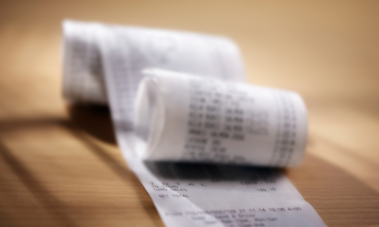 A large, partially rolled up receipt