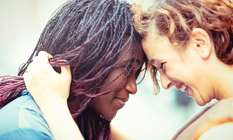 Lesbian couple embracing tenderly