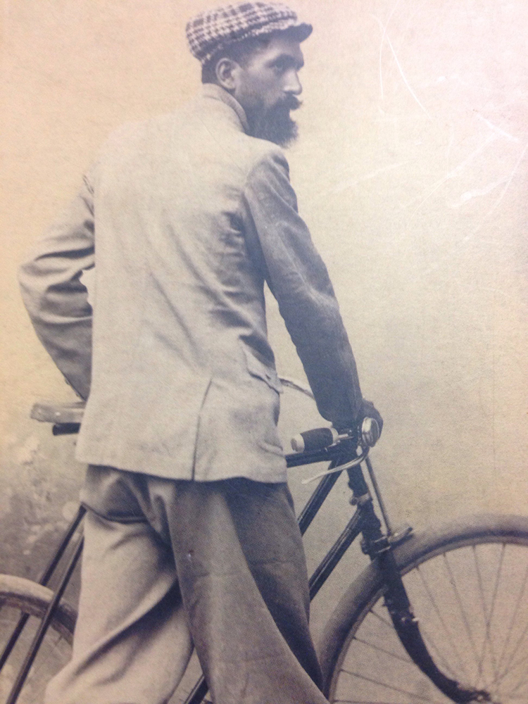 Antonio Pezzoli with a bicycle