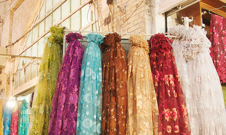 Colorful synthetic scarves at market