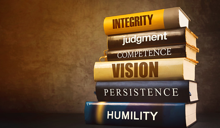 Stack of books with leadership qualities