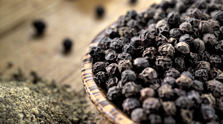 Whole and ground black peppercorns