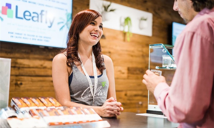 Budtender talking to customer at Caliva dispensary in San Jose, California