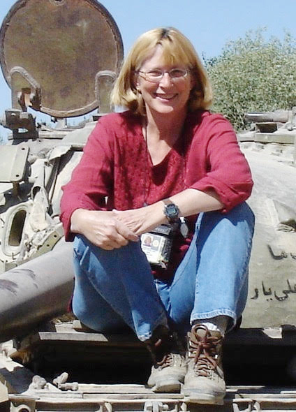 Former Cook County, Illinois prosecutor Inge Fryklund seated on a tank