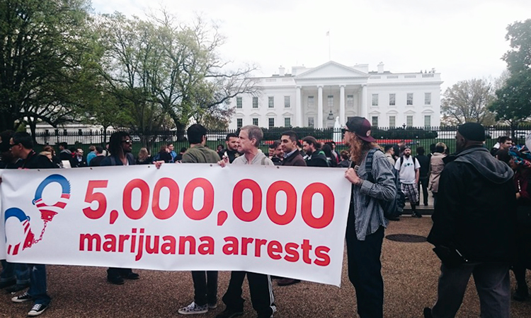 "Cannabis advocates hold ""5,000,000 marijuana arrests"" poster in front of the White House"