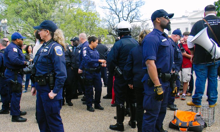 Officers keeping peace at the Reschedule 420 protest outside the White House