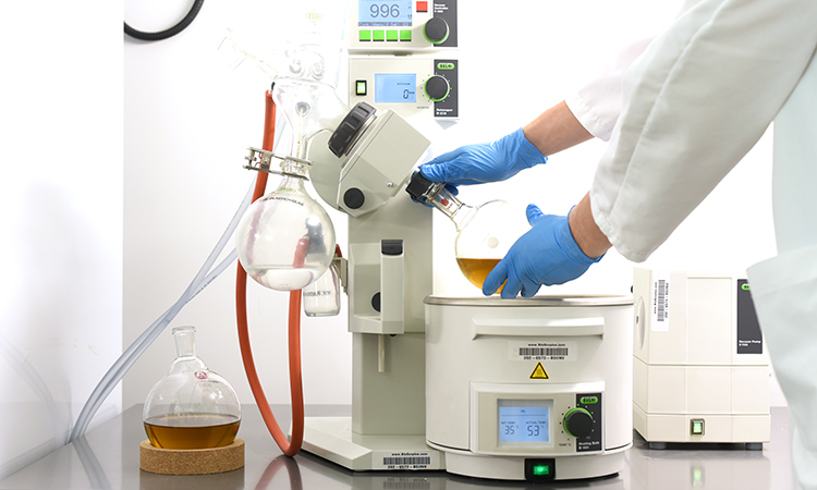 A medical worker using cannabis extraction equipment in the Tilray lab