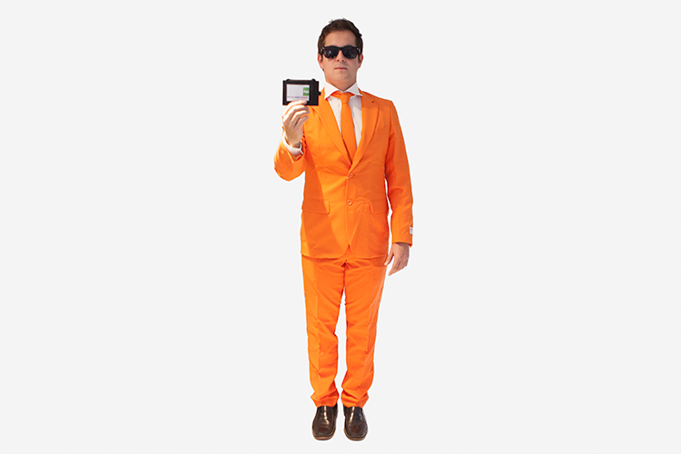 Man dressed up in an orange suit pretending to be a secret agent