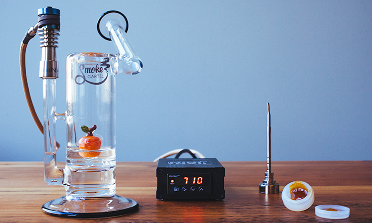 "Cannabis concentrate ""dabbing"" tools: electric nail, enail, concentrate container, and glass dab rig"