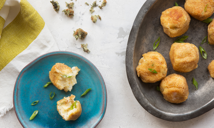 Cannabis-infused mac n' cheese ball edibles on plates next to cannabis flower