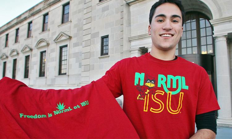 Iowa State University student holding NORML cannabis t-shirt