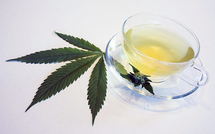 Cannabis leaf with a cup of tea
