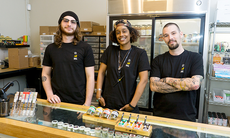 Budtenders at LA Patients and Caregivers Group with Marley Natural products