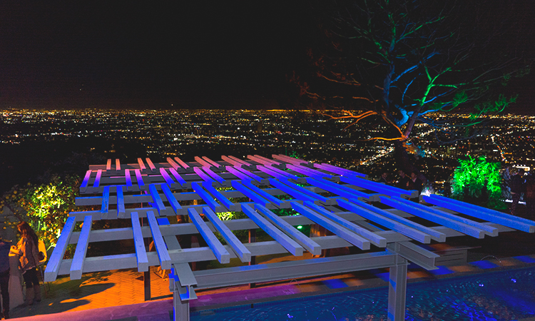 A lighted rooftop overlooking the city of Los Angeles