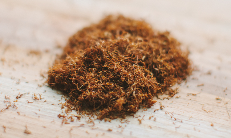 A large pile of loose-leaf rolling tobacco