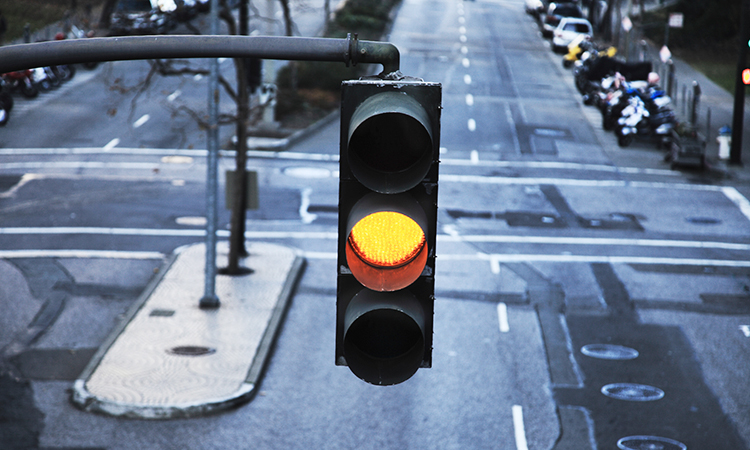 Yellow traffic light in city