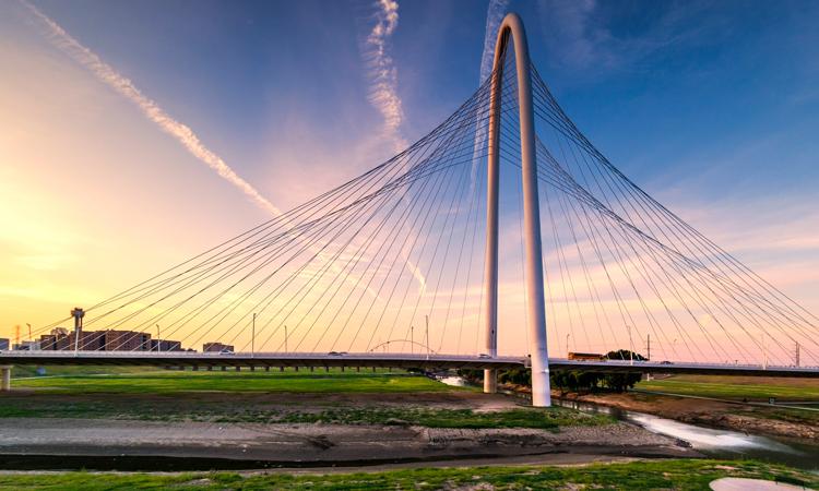 Bridge outside of Dallas, Texas overlooking farm at sunset