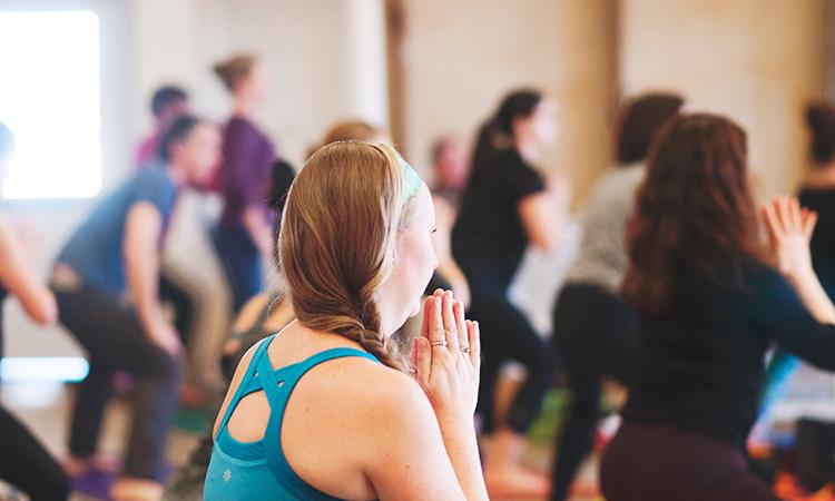 Woman doing yoga at yoga studio