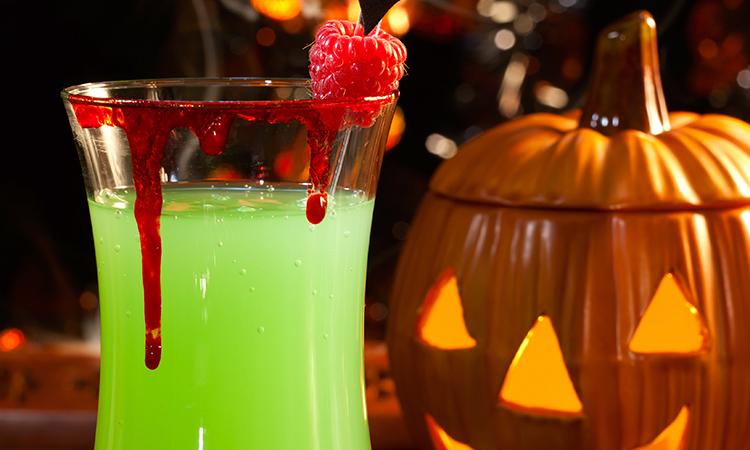 Halloween cocktail in front of pumpkin